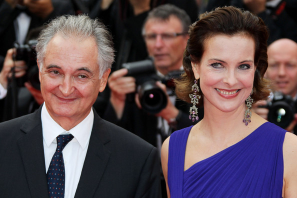 """Carole Bouquet Carole Bouquet and Jacques Attali on the red carpet for the premiere of """"Sleeping Beauty"""" at the 64th Annual Cannes Film Festival."""