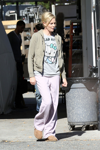 "Charlize Theron Charlize Theron keeps it comfortable on the set of her upcoming movie ""Young Adult"", filming at a gas station in Nanuet, New York. Theron walked about on set dressed in a hooded sweatshirt, Hello Kitty t-shirt, pink sweatpants and Ugg boots."