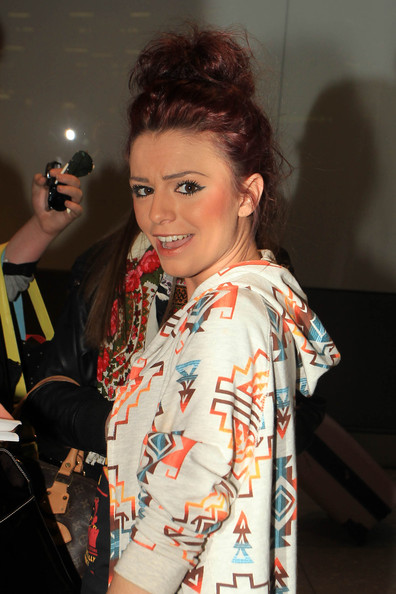 "Cher Lloyd Former ""X Factor"" contestant Cher Lloyd returns to London after a trip to LA. The young rapper was met at Heathrow airport by fans and paparazzi."