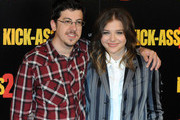 Chloe Grace Moretz and Christopher Mintz-Plasse attend the 'Kick-Ass 2' Photocall at Claridges Hotel in London.