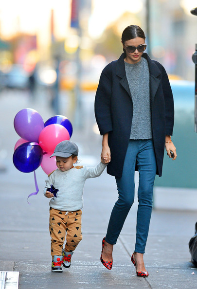 Cute mother and son couple Miranda Kerr and Flynn seen enjoying a Thanksgiving day stroll together while out and about in New York City. The Victoria Secrets model was seen wearing some skinny blue jeans, dark winter coat and black and red heeled shoes while adorable son Flynn was rocking some fashionable trainers and a grey baseball hat while clutching some multi coloured balloons.