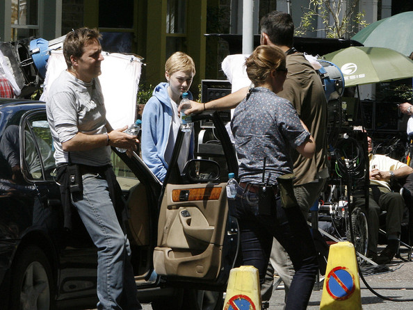 "Dakota Fanning reveals a new cropped hairdo as she films scenes with Olivia Williams and Paddy Considine for ""Now Is Good"" in London. The actress plays a girl dying of Leukemia who makes a list of things to do before she dies."