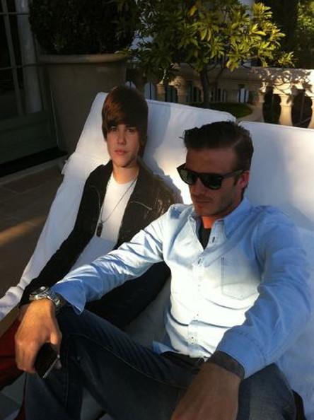 David Beckham David Beckham sits on a sun lounger next to a cardboard cut out of pop star Justin Bieber. His wife Victoria Beckham, 36, posted the image on her Twitter site, and tweeted: 'OMG!!!! A visitor just arrived!!!! Guess who???? 'And now he is sunbathing... He took my sunbed.'' The cut out is thought to belong to the Beckham's son, eight-year-old Romeo, who is a huge Bieber fan. Beckham recently revealed that Romeo asked his parents if they could name their unborn baby girl after Bieber. Photograph: © Victoria Beckham via Twitter. All Rights Reserved.