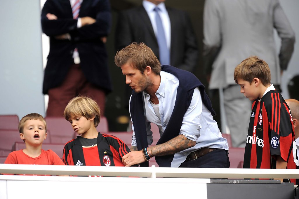 David Beckham watches the Arsenal v AC Milan match his ...
