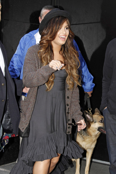 "Demi Lovato Singer Demi Lovato, wearing a fedora with a grey tunic dress, makes an appearance on ""Good Morning America"". The 19-year-old ""Skyscraper"" singer says she wants to be a positive role model to her teen fans, after seeking help during a public meltdown last year where she sought treatment for depression."