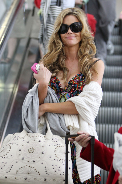Denise Richards arrives in a colorful summer dress and flip flops at LAX  Airport from her Montreal flight. The 39 year old actress is set to join  the cast ... 0e3530985d1