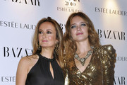 """Natalia Vodianova and Lucy Yeomans at the Harper's Bazaar """"Women of the Year Awards"""", held at One Mayfair in London."""