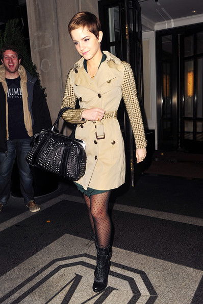 "Emma Watson Tuesday November 16 2010..""Harry Potter"" star and Burberry model, Emma Watson emerges from her New York hotel wearing a stunning studded trench and matching handbag."