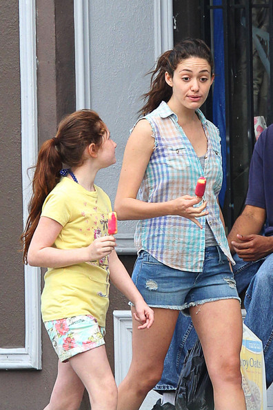 "Emmy Rossum enjoying a popsicle in the sunny Californian sun on the set of hit Showtime series, ""Shameless."" The show surprised the network by boasting excellent ratings in its debut season and will return for a second in January of next year."