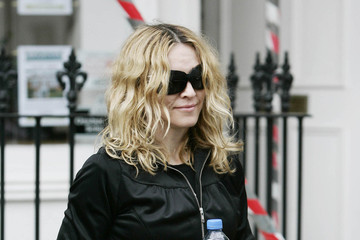 H&M FILE PHOTO: MADONNA'S LATEST GLOVE AFFAIR The real reason Madonna always wears gloves, to hide those ageing hands!!