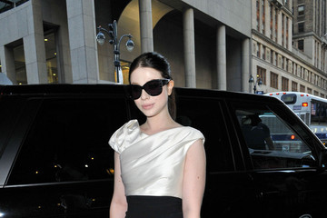 Georgina Michelle Trachtenberg, looking sleek in a white and black dress, makes her way into the Marchesa Spring Fashion Show at New York Fashion Week in New York City