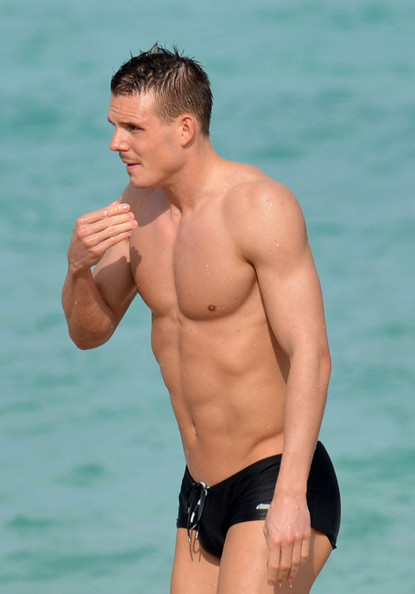 German footballer Alexander Meier and seen enjoying a dip in the ocean while on vacation with his girlfriend in Miami.