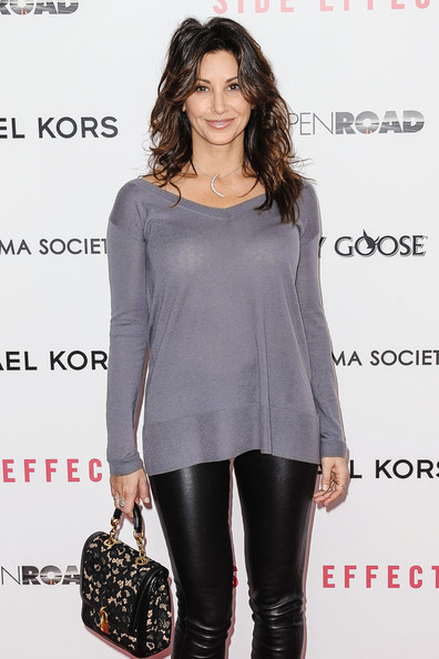 At the side effects premiere 2 in this photo gina gershon gina gershon