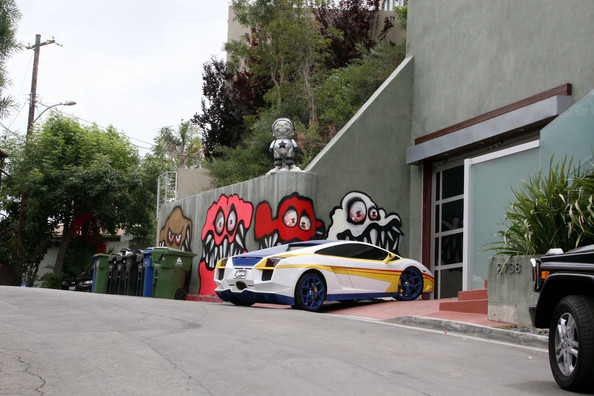 Graffiti art on Chris Brown's home has reportedly angered neighbors in his swanky Hollywood Hills neighborhood and led to him being cited. Brown's home is seen here covered with graffiti murals, which reportedly led to neighbors complaining to an LA city councilman before Chris was cited for 'unpermitted and excessive signage' on the property. The rapper, who has had a notorious on and off relationship with Rihanna, is said to be facing fines if he does not remove the art promptly.