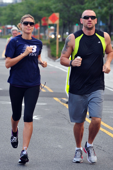 Model Heidi Klum goes for a morning jog in New York City with her bodyguard.  The fit mom ran over 3 miles in her New Balance gear!  .