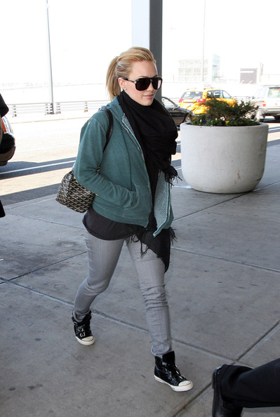 Hilary Duff walks up to the airport, wearing skinny grey jeans and a green zip up sweatshirt, to catch a flight out of New York. Hilary started off her morning with an appearance on