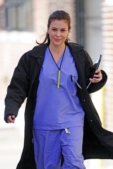 "Alyssa Milano, wearing a nurse uniform and a Mindy Hutchins name tag, walks onto the set of the upcoming film ""New Year's Eve"" in NYC."