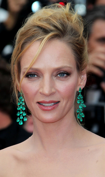 """Uma Thurman attends a screening of """"Midnight in Paris"""" on the opening night of the Cannes Film Festival. The film, which is directed by Woody Alan, opened at the Palais des Festival to good reviews."""