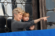 """Jane Pitt, Brad Pitt's mother, holds onto Knox as the two enjoy the sights at their balcony in Venice, Italy. Angelina Jolie is currently still filming scenes for her upcoming film with co-star Johnny Depp, """"The Tourist."""" The two were spotted shooting a handcuff scene just yesterday as they filmed in a Motoscafo boat on the Grand Canal. Brad Pitt allegedly had his mother flown out last week to Europe to help him babysit his six children with Jolie."""