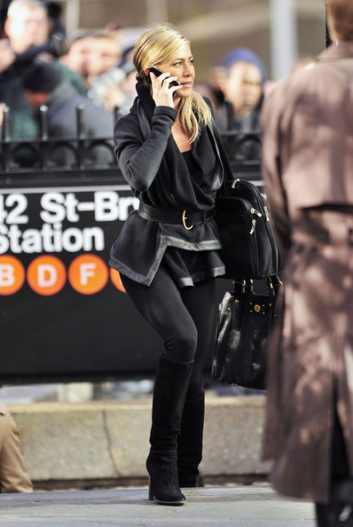 "Jennifer Aniston seen filming the upcoming comedy ""Wanderlust"" at the Bryant Park Subway, talking on an iPhone 4. The Paul Rudd comedy is expected to be released sometime next year."
