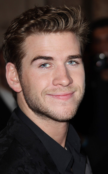 "Liam Hemsworth attends the ""Hunger Games"" movie premiere, viewed by 1,500 fans at the Gaumont Marignan Cinemas on the prestigious Avenue des Champs Elysees in Paris."