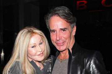 Jocelyn Wildenstein Jocelyn Wildenstein aka 'The Cat Woman' who has spent thousands of dollars in plastic surgery transforming her face to look like a cat seen with her boyfriend Lloyd Klein leaving the BOA Steakhouse in Hollywood