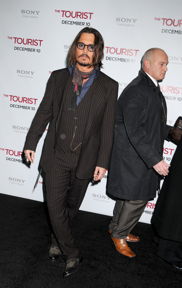 Johnny Depp A dapper Johnny Depp on the red carpet at the world premiere of