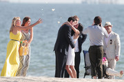 """Josh Hopkins asks Courtney Cox to marry him while filming scenes for TV show """"Cougar Town"""" on Long Beach. Fellow cast members Busy Philipps, Christa Miller, Dan Byrd and Ian Gomez also take part in the scene as participants in the ceremony."""