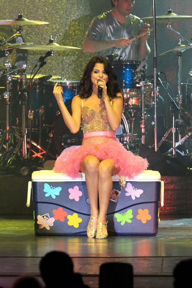 Justin Bieber Selena Gomez wows the crowd as she performs live on stage in Boca Raton, Florida. The Disney darling cheekily sat on a cooler with pictures of boyfriend Justin Bieber on it for one number, and used a personalised, glittery microphone throughout her performance.