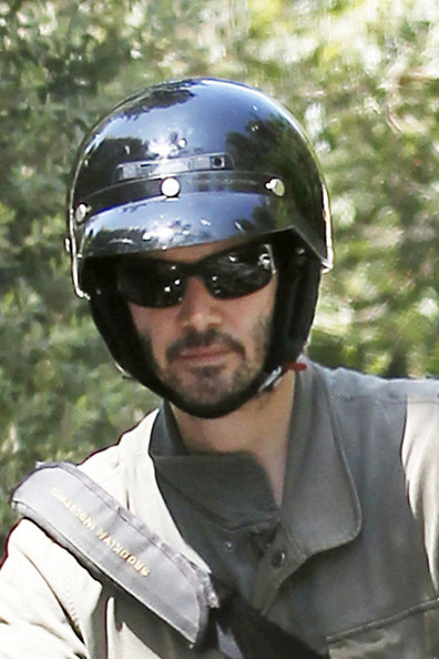"KEANU GOES COMMANDO - ""Speed"" actor Keanu Reeves goes for a ride on his vintage 1972 Norton Commando Roadster in Hollywood on his 47th birthday today."