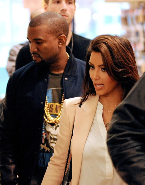 Kanye West Kim Kardashian and Kanye West have lunch together before going shopping at FAO Schwarz toy store amid speculation over their relationship. Kanye and Kim, who could be seen wearing Mickey Mouse ears at the toy store, sparked dating rumors after they were seen out on the town last night. Kim was photographed leaving Kanye's apartment building this morning wearing the same clothes as the night before.
