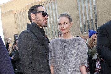 Kate Bosworth and Michael Polish A guest attends the Unique by Topshop show during London Fashion Week