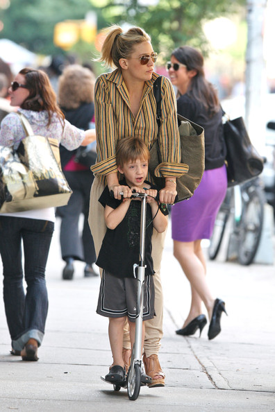 Ryder Robinson Kate Hudson rides on son Ryder's scooter as the mother-son duo spend time together while out in NYC. Hudson, keeping it casual in khaki capris, wedge heels, and a striped button up holds onto Ryder's Razor scooter as the two walk hand-in-hand later.
