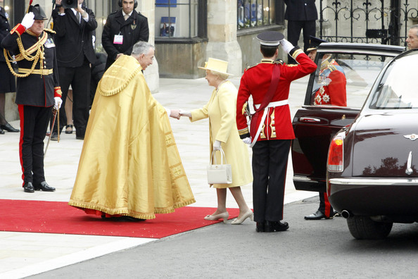 The Queen meets the Dean of Westminster as she arrives at Westminster Abbey for the wedding of Prince William and Kate Middleton.  Masses of crowds lined the streets to catch a glimpse of the new Duke and Duchess of Cambridge emerge from the church.