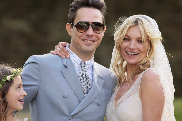 Kate Moss and Jamie Hince pose together during their first few moments as a married couple following their wedding ceremony at Southrop Village in Cotswolds.