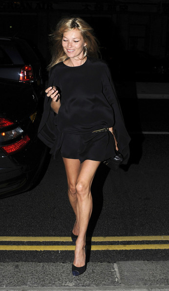 Kate Moss A newlywed Kate Moss shows her slender figure in a black dress after an evening at the Wolseley restaurant in London. Kate dined with her now husband Jamie Hince and a female friend.
