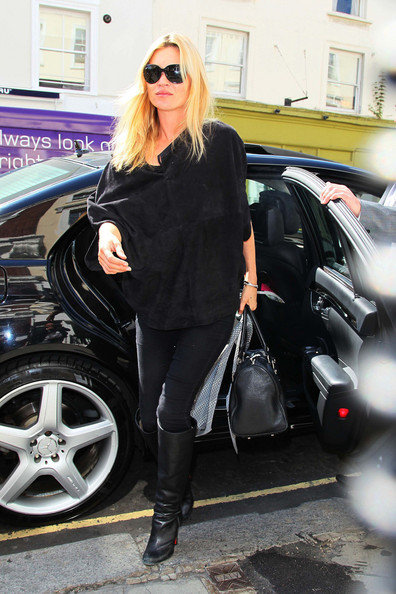 Kate Moss hits the shops with her daughter Lila Grace and a female while her fiance Jamie Hince spent the day alone. Kate shopped then stopped for lunch at a Japanese restaurant in London. Kate is engaged to marry Kills frontman Jamie Hince and the pair are set to marry this Summer.