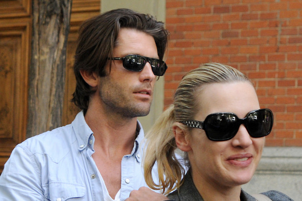 Kate Winslet Kate Winslet and her new boyfriend Louis Dowler hold hands as they stroll through the streets of Madrid.