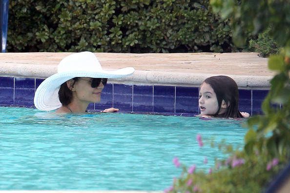"Katie Holmes Katie Holmes and daughter Suri Cruise spend their afternoon swimming and relaxing by the pool at their Miami hotel. The mother/daughter duo were seen splashing around in the pool together before hanging out on poolside lounge chairs. Suri, sporting a pink bikini, could be seen drying off with a large Cinderella towel. Katie Homes and her daughter Suri are reportedly in Miami visiting Tom Cruise, who is shooting the upcoming film ""Rock of Ages""."