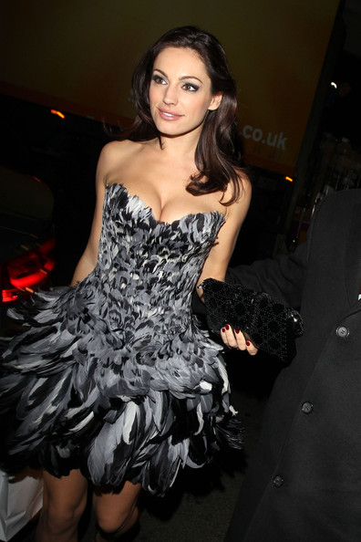 Kelly Brook Bird of Paradise! Kelly Brook wears a striking dress made of black and white plumage. The model/actress attended the Dior Private dinner at Claridges hotel.