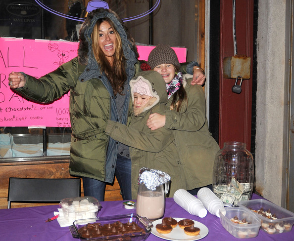 """Real Housewives of New York"" star Kelly Killoren Bensimon and daughters Sea (brown hat) and Thaddeus (pink hat) raise money for the Animal Haven, SoHo, with some home-made goodies."
