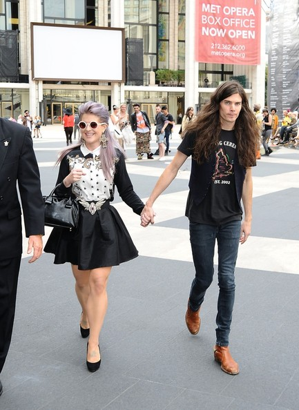 Holding hands while leaving from a fashion show in new york city
