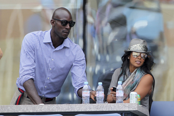 Kevin Garnett Kevin Garnett with his wife Brandi watching a match
