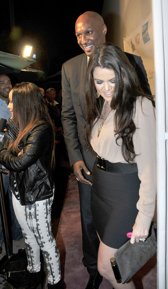 Khloe Kardashian Despite the rain Khloe Kardashian -Odom and husband Lamar manage a big smile as they dine out at Philippe by Philippe Chows in West Hollywood.