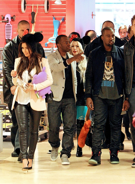 Kim Kardashian Kim Kardashian and Kanye West have lunch together before going shopping at FAO Schwarz toy store amid speculation over their relationship. Kanye and Kim, who could be seen wearing Mickey Mouse ears at the toy store, sparked dating rumors after they were seen out on the town last night. Kim was photographed leaving Kanye's apartment building this morning wearing the same clothes as the night before.