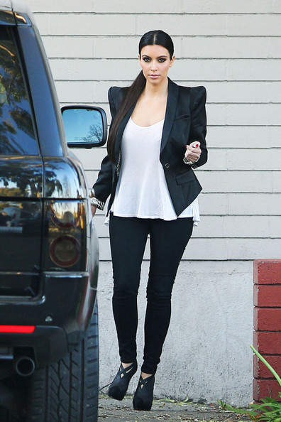 "Kim Kardashian Kim Kardashian, star of ""Kourtney and Kim Take New York,"" departs a studio in Los Angeles wearing a black blazer with shoulder pads. It was recently announced that after Kim Kardashian filed for divorce from her husband of 72 days, Kris Humphries filed a request to annul their marriage on the basis of fraud."