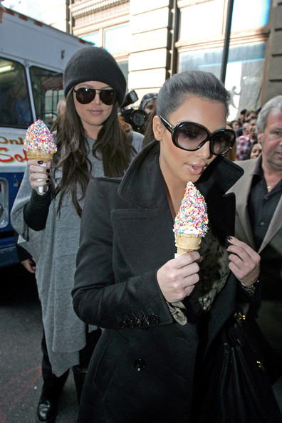 Kim Kardashian Kim Kardashian and her sister Khloe get ice cream from an ice cream truck in SoHo surrounded by photographers. The sisters are seen with matching but different colored Hermes handbags.