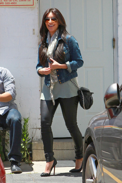Kim Kardashian shows off her $2 million engagement ring while out running errands in Los Angeles. Wearing a denim jacket and leather trousers, Kim first stopped off at a salon to get her hair done. After getting her hair done, Kim stopped off to pick up some takeout food before heading home. Kim's engagement ring was designed by Lorraine Schwartz and features a 16.5 carat emerald cut center stone flaked by two 2 carat trapezoids.