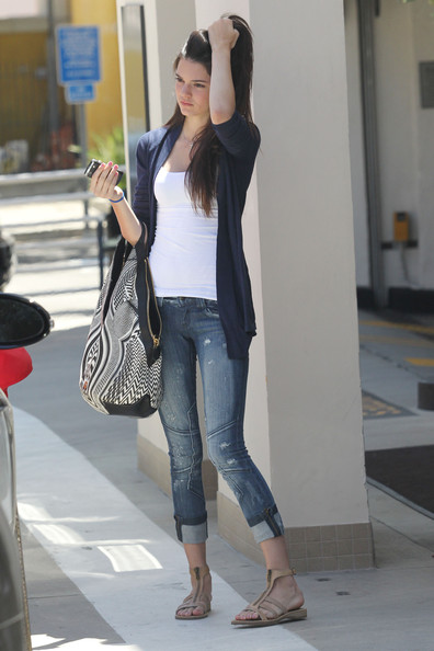 Kendall Jenner Kourtney Kardashian and her mother take turns with Kourtney's baby Mason during a shopping trip in Beverley Hills. Kourtney's half sisters, Kendall and Kylie, also accompanied them on the family outing. They all went to eat a 'Nate n Al's' on Beverly Drive and then went shopping at Ralph Lauren.