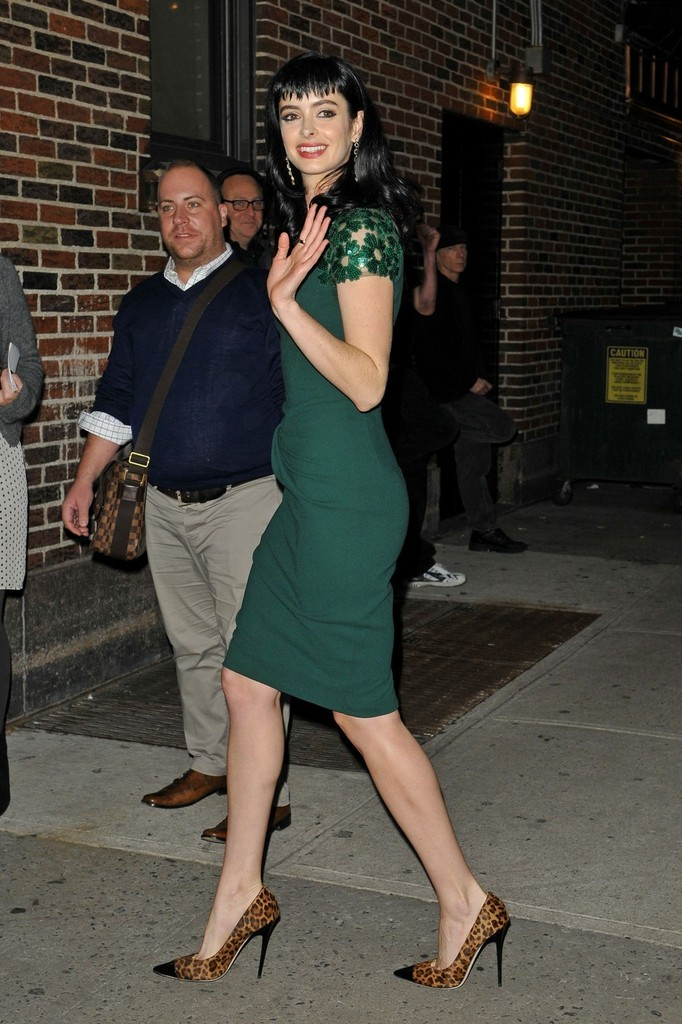 green dress and leopard print shoes